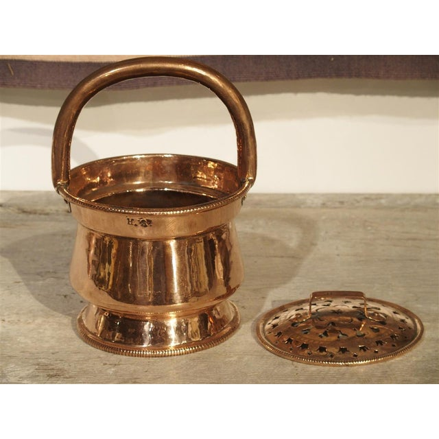 This charming antique copper piece is quite rare. It dates toward the end of the Louis XIV period, circa 1690, and it is...