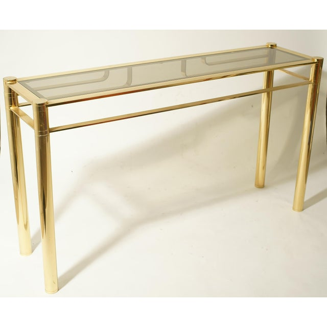 A stunning gilded console with smoked glass top. Italian design school of Romeo Rega ca.1960s