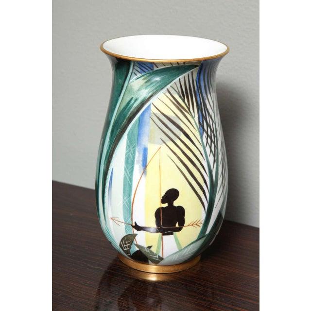 Robert Bonfils (1886-1972) for manufacture National Sèvres. Art Deco porcelain vase decorated with polychrome enamel of a...