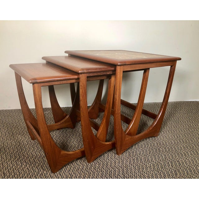 Set of 3 nesting tables. Made by G Plan. Asian teak accented with darker afromosia (African) teak. Excellent condition....
