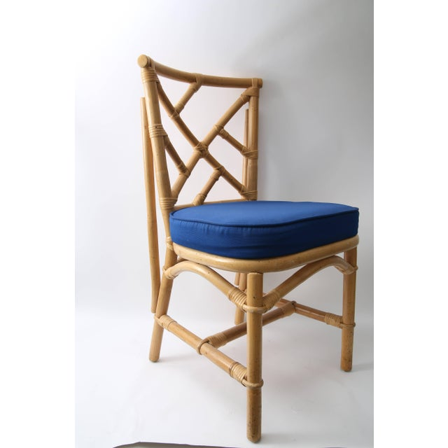 This stylish set of four side chairs are fabricated in bamboo with a fret-work Chippendale pattern and upholstered in a...