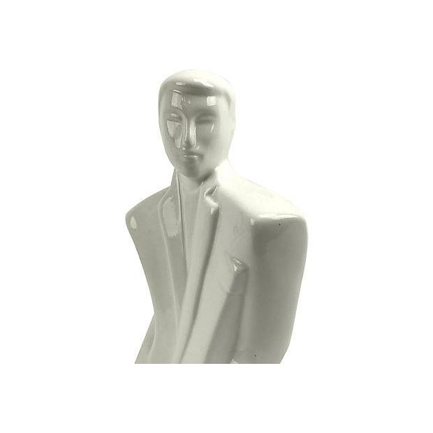 "1980s gentleman bust in the angular Nagel-inspired Art-Deco style. Marked, ""Taiwan"" on bottom. Dimensions: 6"" L x 2.75"" W..."