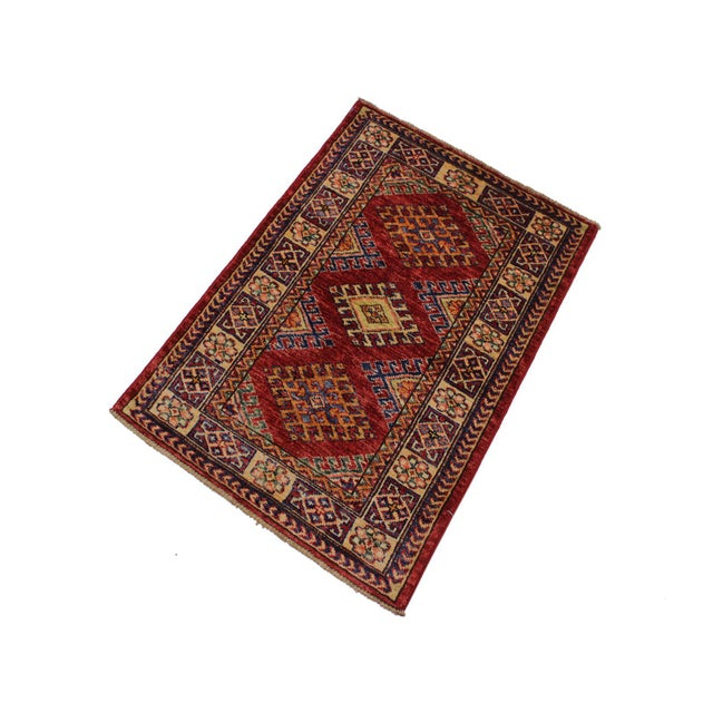 Create a new dimension of style in your home with this breath-taking hand-knotted rug featuring incredible luxurious...