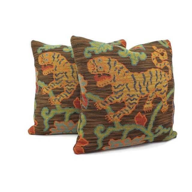 From F. Schumacher's Classics Collection is Khotan Weave in the color Sable pillow cover. The front features an exotic...
