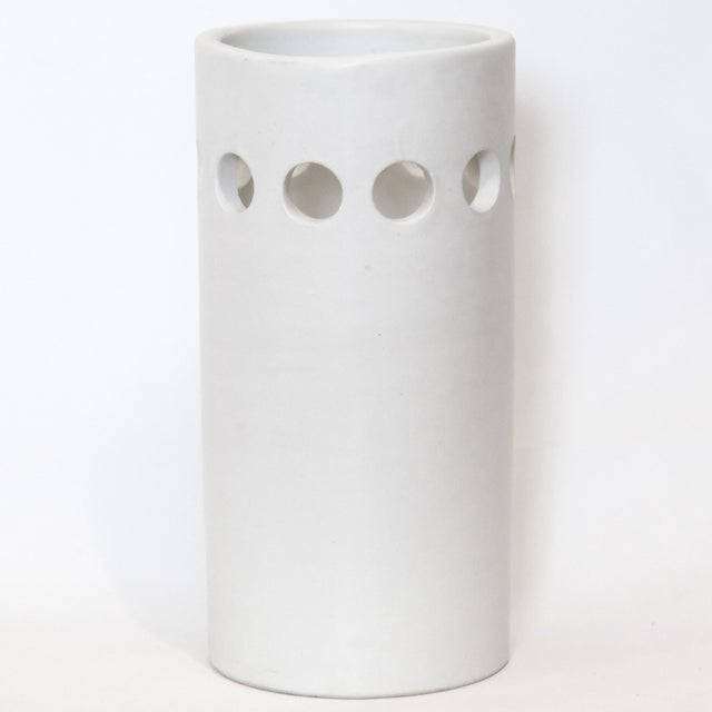 Italian minimalist white cylindrical ceramic vase with one row of pierced circles, circa 1960s. Attributed to Bitossi with...
