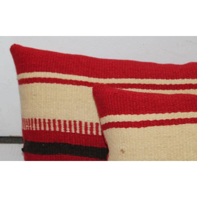 These amazing striped weaving's are from a Mexican saddle blanket and have red cotton linen backings. Sold as a pair.
