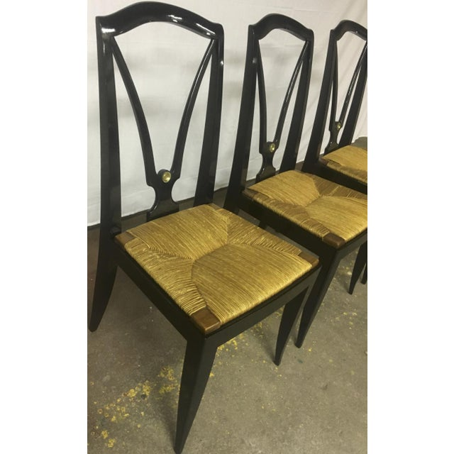 Maison Jansen refined set of 6 black dinning chairs with rush seat.