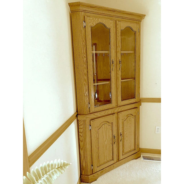 "Solid natural oak corner hutch in exceptionally good condition. Clear finish. 75"" H x 38¼"" W x 16"" D with a flat back..."