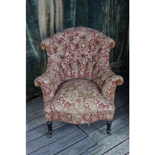 Pair of Napoleon III armchairs in a printed velvet. They have rolled arms and back. The back is heavily tufted and...