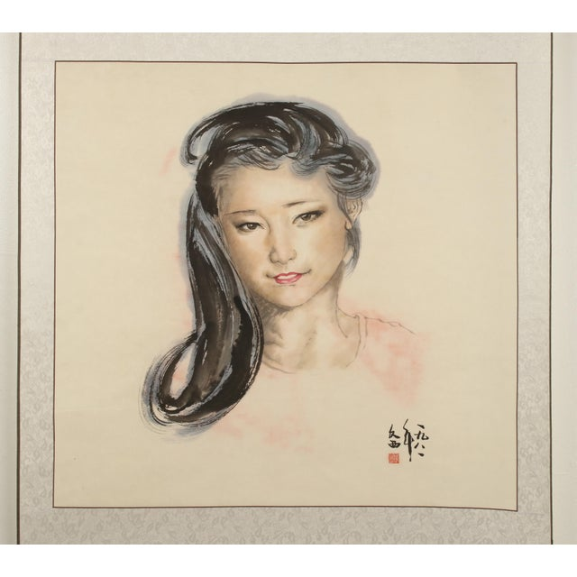 A stunning portrait of a beautiful Chinese woman painted on a scroll. She has a warm smile on her face and her beautiful...