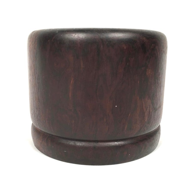 A turned solid rosewood vessel a bowl or vase, of cylindrical form with circular foot ring. Carved from the solid, heavy,...