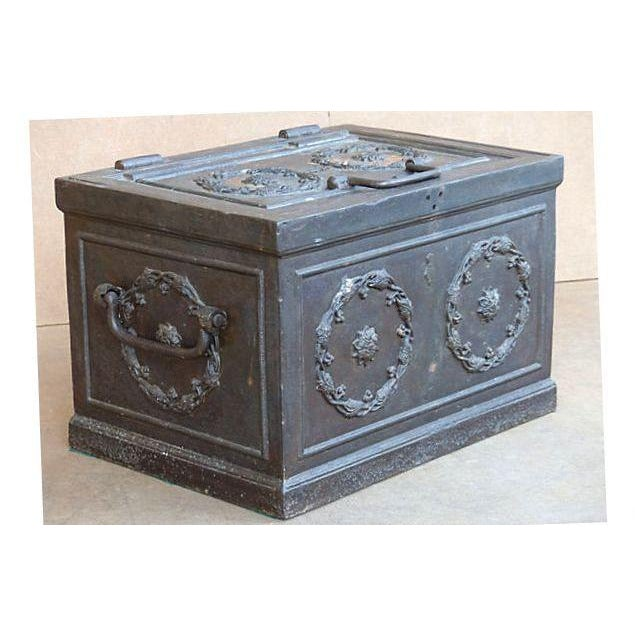 An antique iron safe, very thick and heavy. Inside has three removable wood boxes and an open storage area. Safe has no...