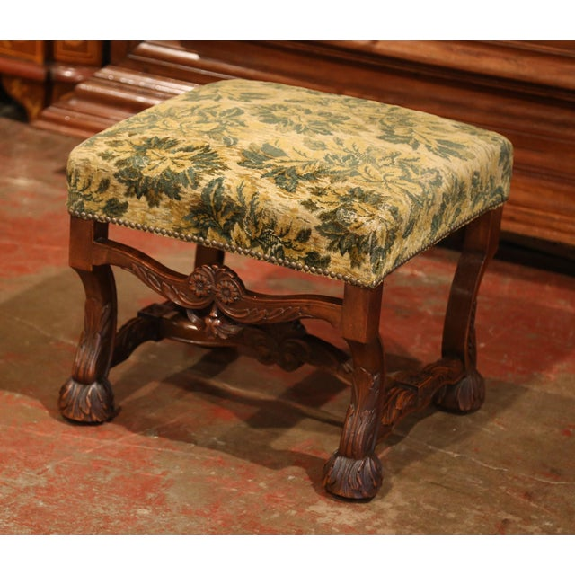 Elegant antique stool from southwest France; crafted circa 1870, the fruit wood stool features four carved scrolled legs...