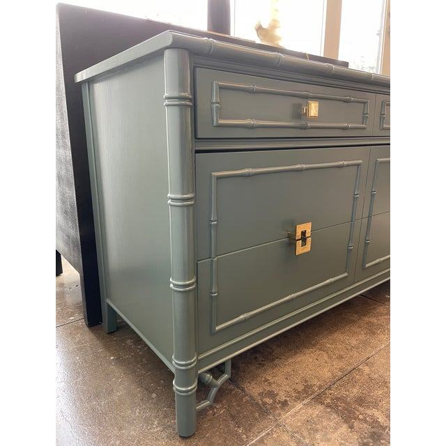 1960s Thomasville Faux Bamboo Chinoiserie Lowboy dresser/chest with 3 drawers. This vintage piece was freshly painted and...