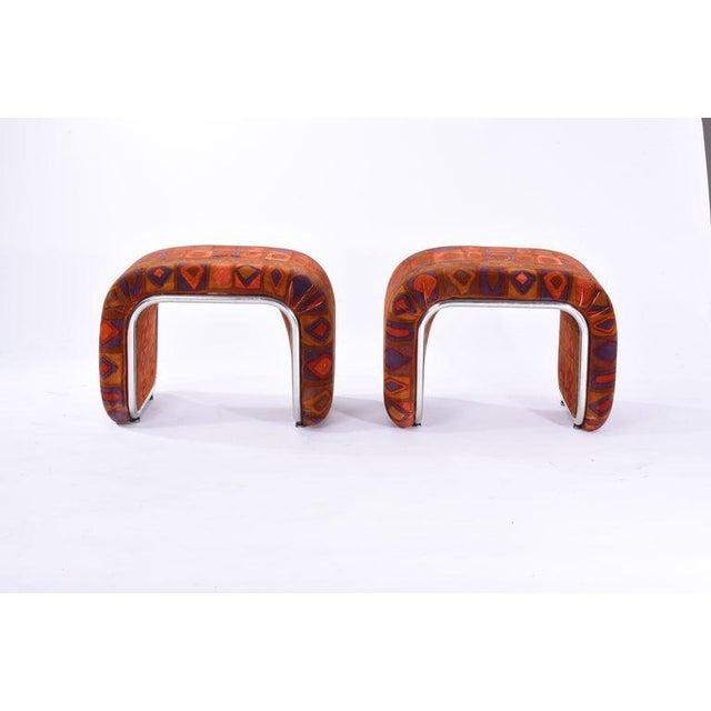 """Waterfall stool ottomans in vibrant Jack Lenor Larsen """"Caravan"""" velvet with chrome framing the form."""