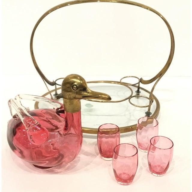 Unique Vintage Art Deco Cranberry Art Glass Duck Decanter Set, antique brass tray with glass shelf, four glasses, belonged...