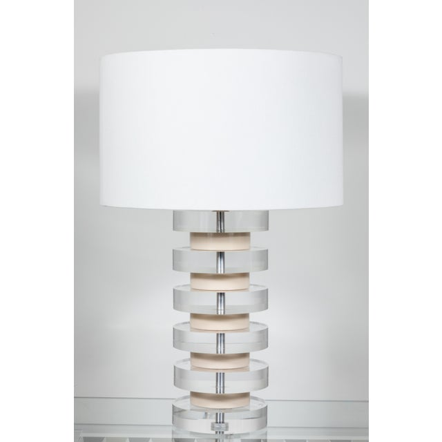 Impressive pair of stacked lucite lamps by Karl Springer, 1980's. Lamps have been completely re-wired and include new...