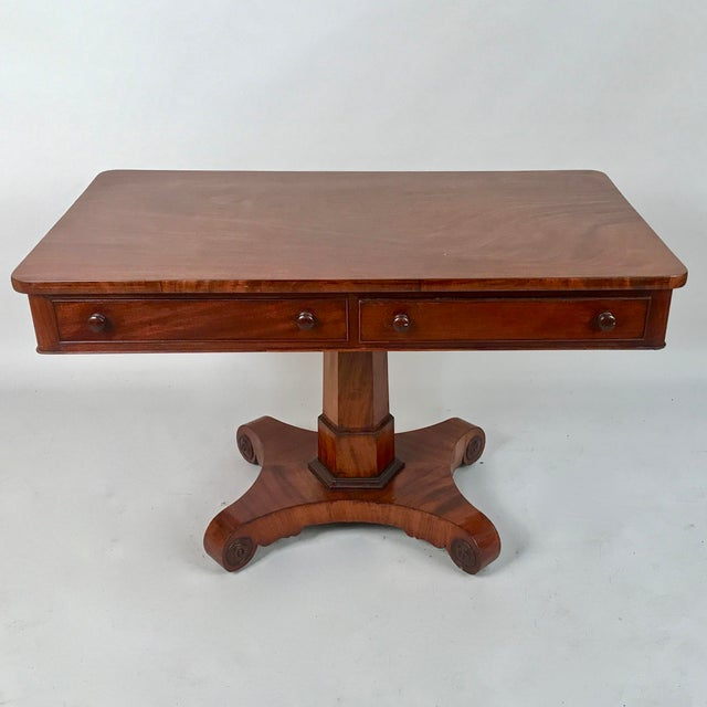 Circa 1825 George IV Mahogany Writing Desk. This beautiful desk has two drawers that slide easily when opening them. It...
