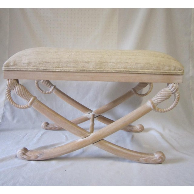 "Pickled wood Bench upholstered in an ivory shantung fabric. Base has an interesting ""crossed sword"" detail. Overall..."