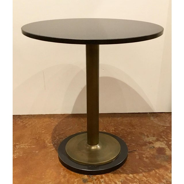 Stylish Currey and Co. modern black marble and antique brass side table, showroom floor sample