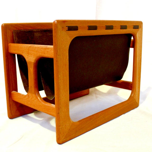 Danish Modern teak and leather magazine rack by Salin Mobler. The piece has a sculptural teak frame and leather slings. In...
