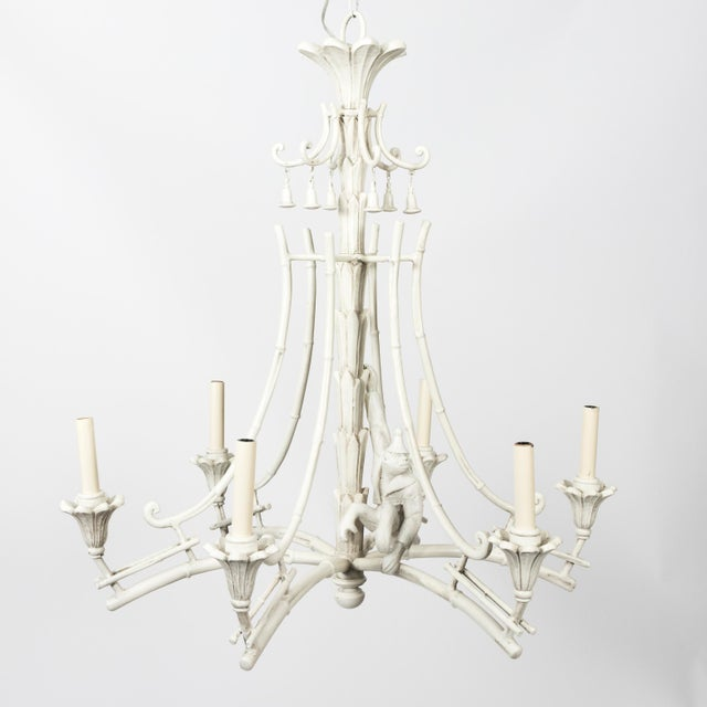 Serge Roche style chandelier. Newly painted in an antique white finish. Chinoiserie hanging bell accents and detachable...
