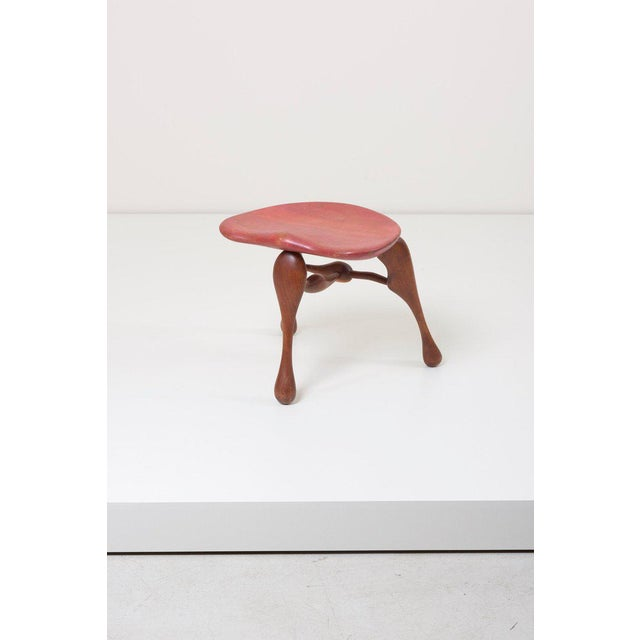 Sculptural handcrafted three legged stool by noted studio furniture maker Ron Curtis.