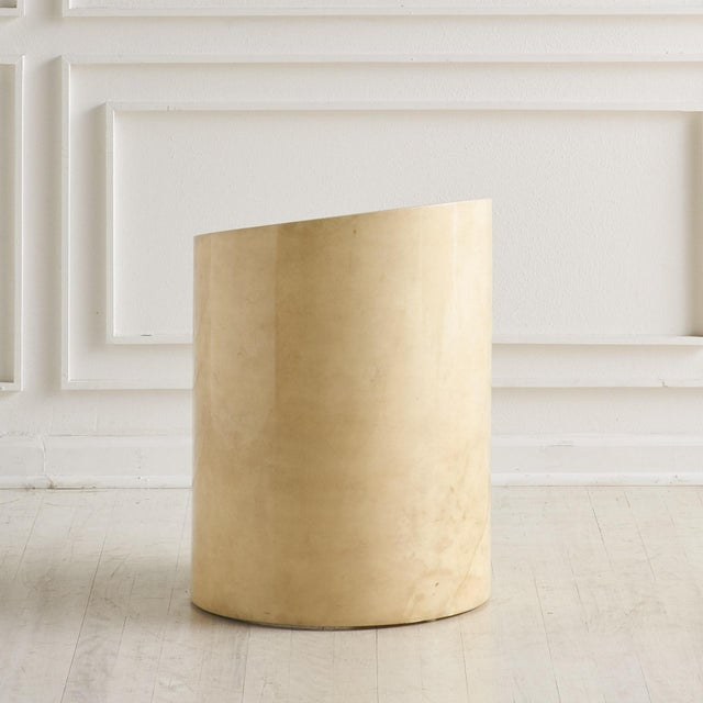 A lacquered parchment side table by Ron Seff with a thick glass top beautifully suspended within the tables circular...