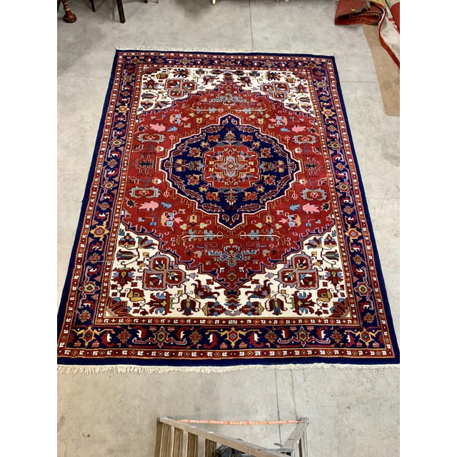 Gorgeous blue, red and white Bahtiari Persian Rug. Bold colors, tight knots. Nice even pile and great vintage condition. A...