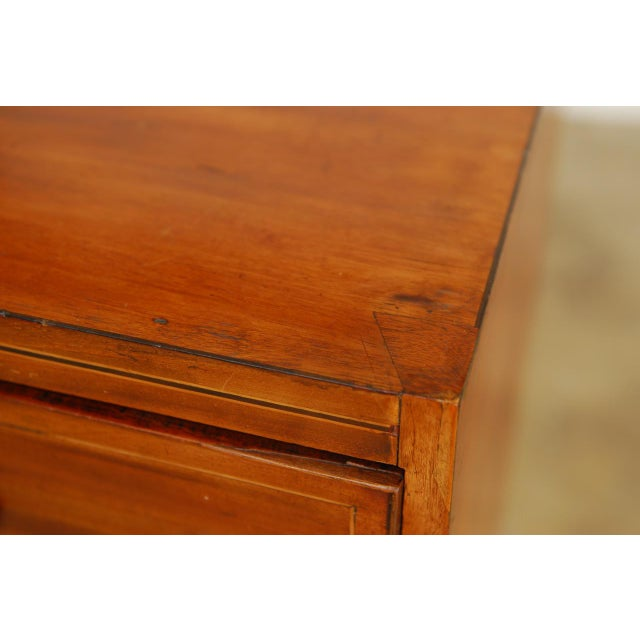 Distinctive 19th century George III period chest of drawers featuring a radiant grain mahogany. The case is fitted with...