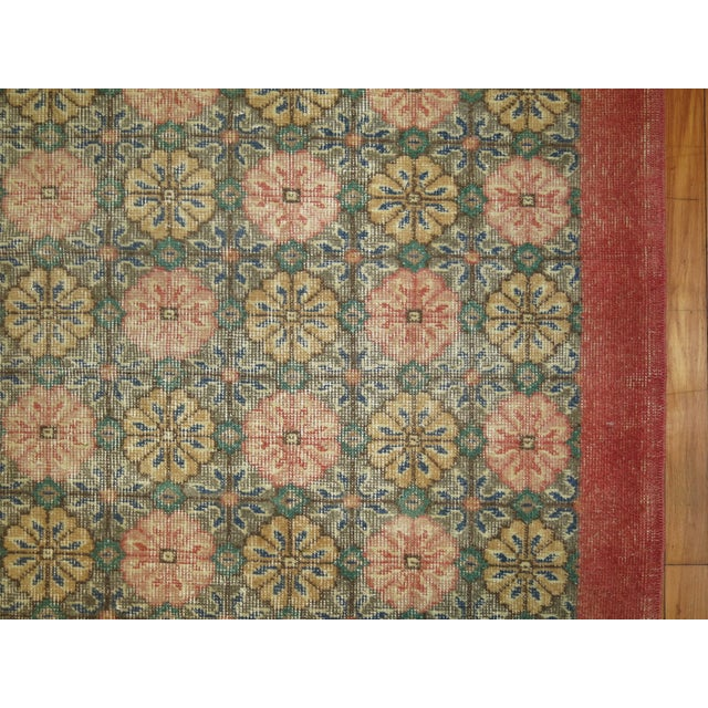 An all over design vintage turkish floral rug with a shabby chic appeal.
