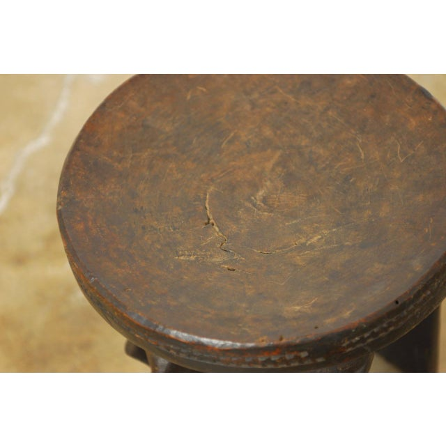 African Carved Tribal Stool with Figural Legs For Sale - Image 4 of 12