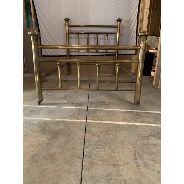 Early 20th Century Brass Low post bed with spindle details, disc finales, on caster feet. Full size bed Very solid frame,...