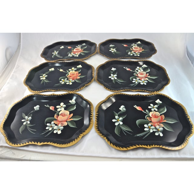 Six hand-painted Tole metal trays with peach and coral roses on a black background rimmed in gold. In excellent, nearly...