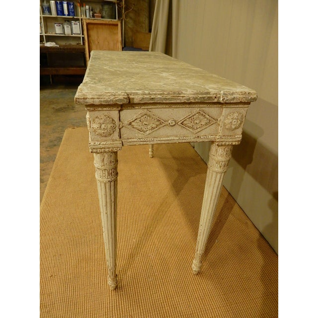 Very good quality 20th c. Louis XVI painted console with marble top.