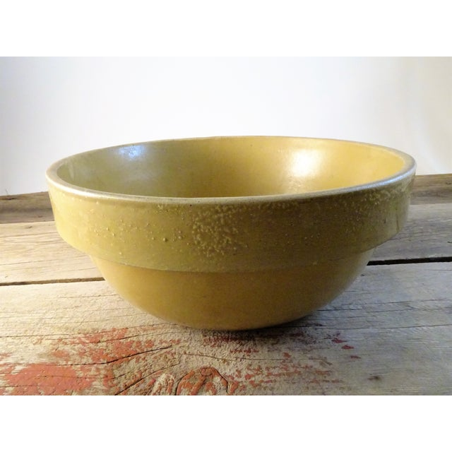 Highly collectible stoneware mixing bowl from the 1900's. Manufactured by Buckeye Pottery Co. Macomb, Illinois. This bowl...