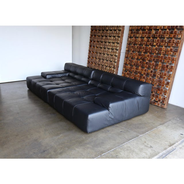 B&B Italia tufty time black leather sofa by Patricia Urquiola. Circa early 2000s.