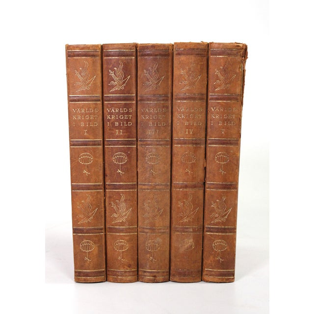 This set of 5 large marbled red books are bound with leather and detailed with gold leafing. Complete in Swedish describes...