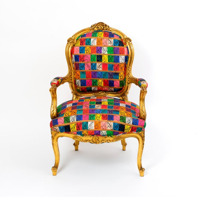 Our vintage Louis XV Style Giltwood Fauteuil will make a statement in any setting. The chair is a vintage piece covered in...