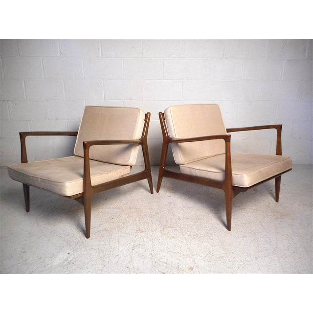 This stylish Danish modern set features a sleek angular design, sculpted armrests, and tapered legs. Deep seats and angled...