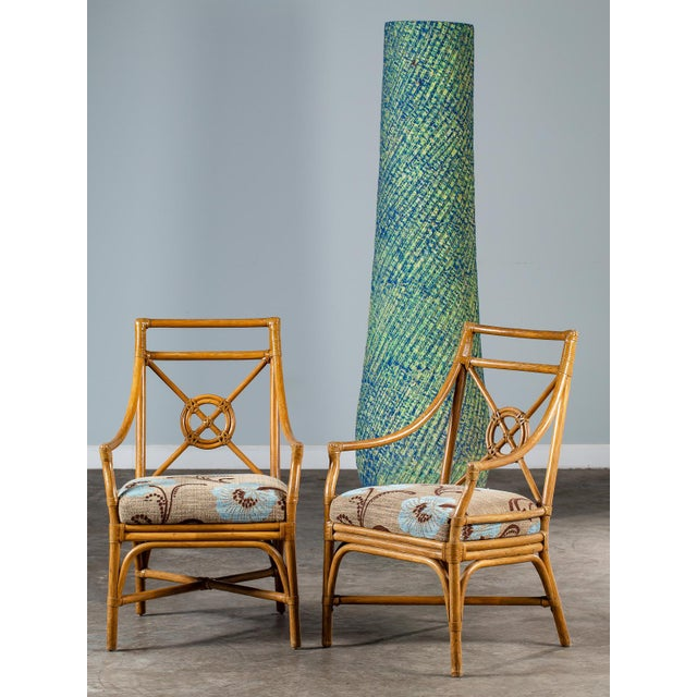 A pair of chic vintage McGuire bamboo chairs with rawhide strapping in the famous Target Backsplat design circa 1970. This...