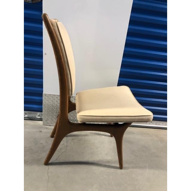 This gorgeous chair was designed by Vladimir Kagan between the 1950-59. Manufactured in the United States. Made of Wood...