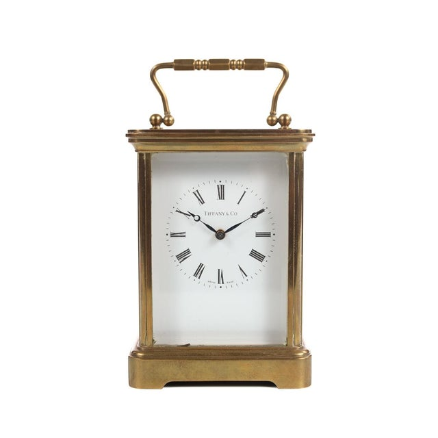 "Tiffany & Co vintage brass carriage clock size 4 x 7"" A beautiful piece that will add to your décor!"