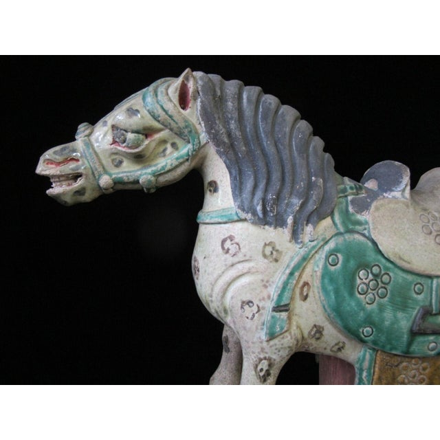 """Chinese Sancai glaze pottery horse on stand. Actual horse measures 13 1/2"""" x 10"""" tall. Stand measures 5 1/4"""" x 3 1/2""""..."""