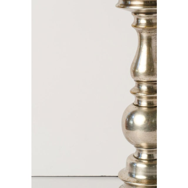 Antique nickel lamp (circa 1910-1930) in baroque style. This Belgian table lamp is newly wired for use within the USA and...