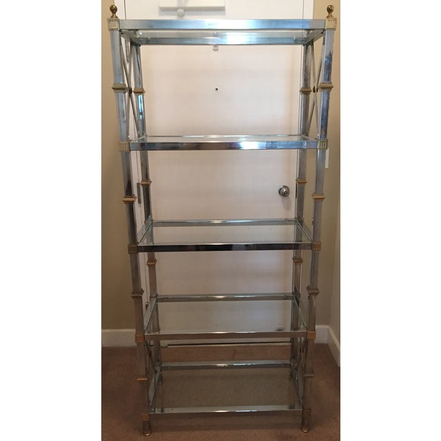 Gorgeous Mid-Century chrome and brass etagere with 5 glass shelves in very good to excellent condition in the style of...