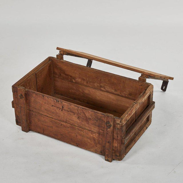 A rustic chest as a coffee table, originating in England, circa 1890.