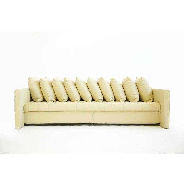 Ten pillow, single cushion architectural sofa, great seat depth (37.50 deep) Retains original paper label to the underside...