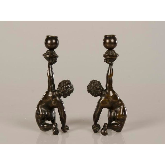 A pair of cast bronze candlesticks each featuring a kneeling putto from Italy c.1880 - Image 4 of 7