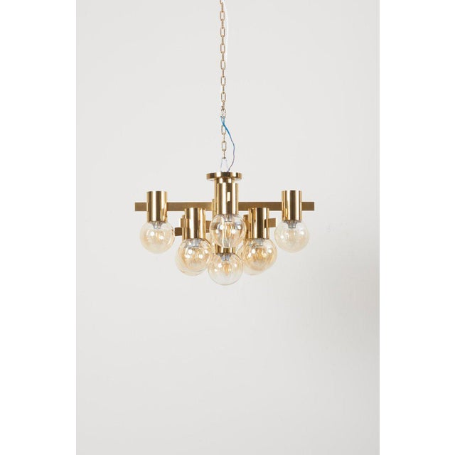 Flush mount lamp designed by Sciolari, Italy, circa 1960s. Shown with nine Murano glass globes and brass mounting. Lamp is...